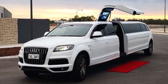 Audi Limo Perth White Wedding Car 14 seater for a Large wedding party in Perth both decorated with white wedding Ribbon. CVL small Charter Vehicles